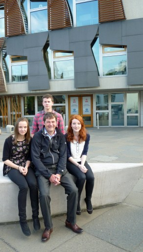 Pupils with SNH photographer Lorne Gill outside the Scottish Parliament