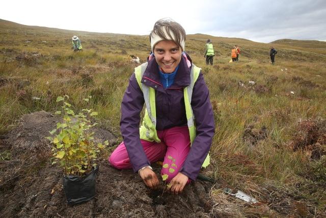 Volunteer planting a downy birch at Dundreggan