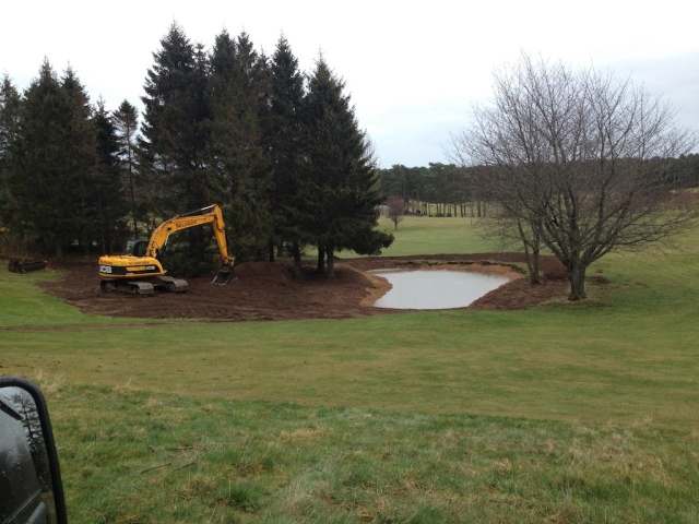 An almost finished great crested newt pond on Forres Golf Course.