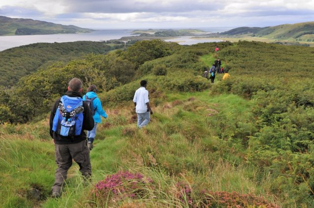 People walking on the summit of the Barr Mor trail at Taynish NNR,