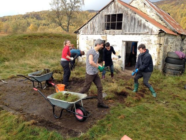 Volunteers clearing hard standing