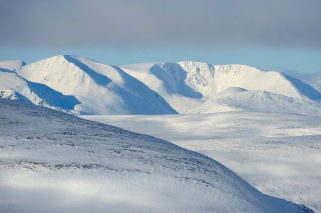 The snow covered mountains of the Cairngorms National Park.