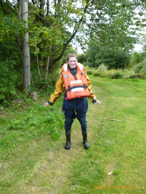Modelling the drysuit before wading through Duddingston Loch. Photo, Gavin Johnson