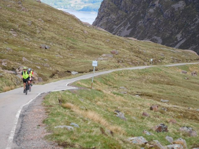 My friend Caroline and me cycling up the Bealach na Ba.