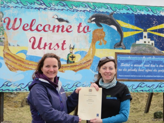 Christine receiving her certificate from Jorunn Clouston in Shetland.