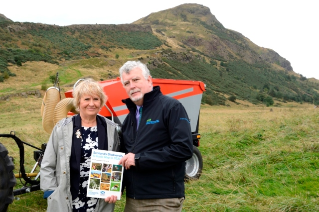 Ian with Roseanna Cunningham MSP, Cabinet Secretary for Environment, Climate Change and Land Reform launching Scotland's Biodiversity, a Route Map to 2020, at Holyrood Park, Edinburgh. ©Lorne Gill/SNH