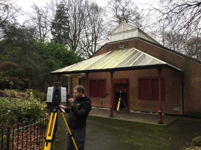 James laser scanning around the exterior of the Victorian building.