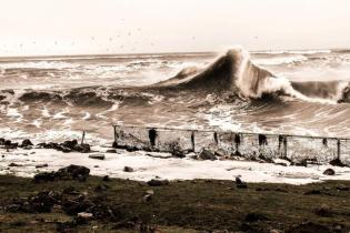 Storm waves affecting Golspie (Highland) in 2012. Shorefront was flooded with rubble and debris washed onto A9 trunk road. (© Anon)