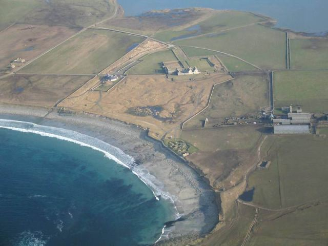 Skara Brae, exposed by coastal erosion in the 19th century has been defended since. Latest surveying techniques used to understand future risks of coastal erosion. (©Historic Environment Scotland)