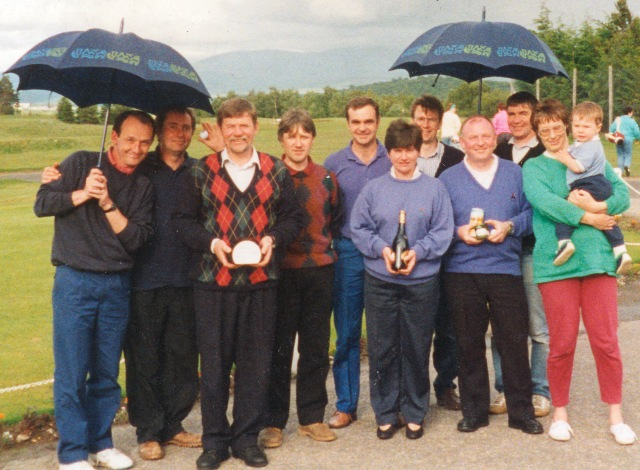 Staff enjoying the annual 'North versus South' golf match in May 1993 at Newtonmore Golf Course, just one year after merger. from left to right:David Yule (guest),Jim Carruthers,Cliff James,Iain Rennick, Unidentified, Dorothy Macdonald, Peter Hutchinson, Dougie Duguid, Peter Duncan and Kristin with a toddler, and a bump.