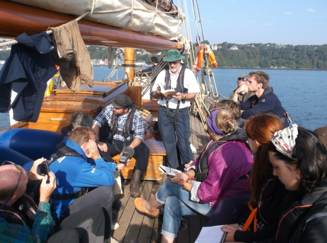Simon Cuthbert reading from Hugh Miller's 'The Cruise of the Betsey' during the 2014 voyage in homage to Hugh Miller. © Martin Gostwick.