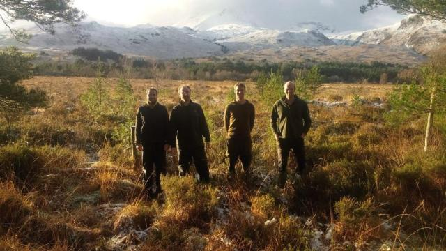 The Beinn Eighe team, with Beinn Eighe in the background. © Doug Bartholomew/SNH