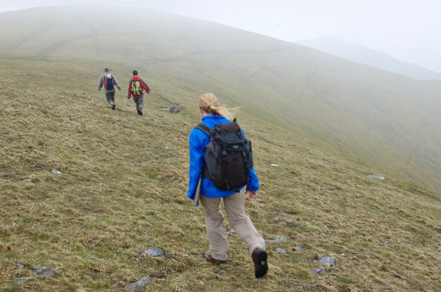 SNH staff on a site visit heading into the mists at the summit of Ben Wyvis. © Lorne Gill/SNH