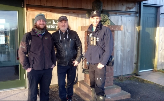 Picture of Adam Murphy (SNH), Bill Bailey and Joe Bilous (WWT) at Sir Peter Scott Observatory hide.