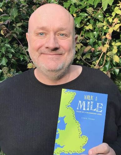 Chris with his book, Walk a Mile: Tales of a Wandering Loon.