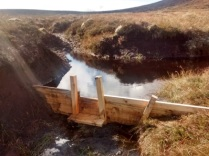 Gully blocking with wooden dams. Note the notch (used to direct water way from the sides and prevent erosion), and the plunge platform (again to prevent the dam being destabilised by the plunging water). ©Lochrosque Estate