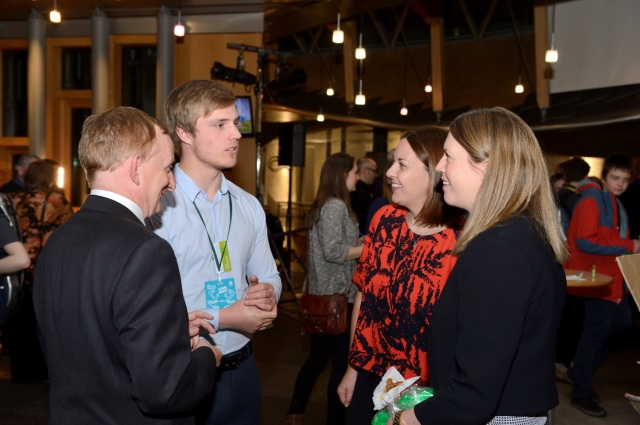 Lewis Gove (SNH Student Placement) talking to Parliamentary Reception attendees including SNH Chair Mike Cantlay and Jenny Gilruth MSP. © Lorne Gill/SNH