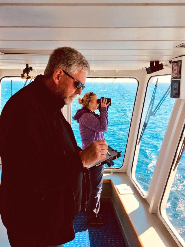 Dr. Jane Dodd surveying while ORCA volunteer Alastair MacDonald records data, ©Lucy Babey/ORCA