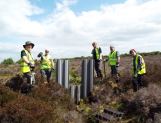 Group of volunteers ditch blocking at Langlands. ©Sara Green/Butterfly Conservation Scotland