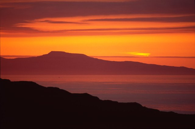 Sunset over Kilmory Glen and the Isle of Skye, Isle of Rum NNR. ©John MacPherson/SNH