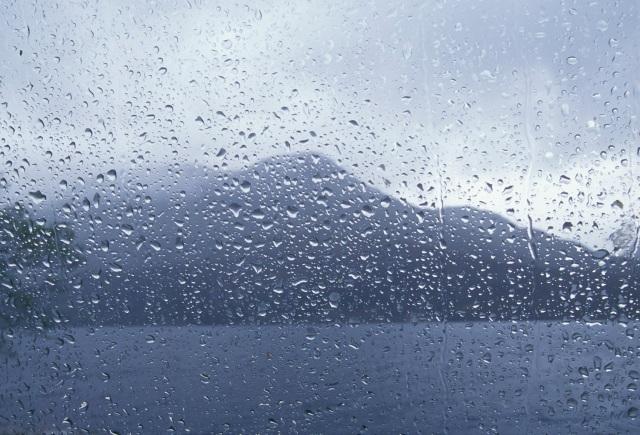 Spring. Loch Maree through car window in rain.