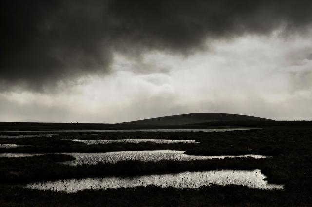 An approaching rain shower on a wet day and a peatland lochan at the Flows NNR Lorne GillSNH2020VISION